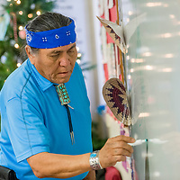 Traditional practitioner Kenneth A. Joe begins a traditional Diné story with a drawing of a cornstalk at the Behavioral Health Department in Crownpoint Wednesday.