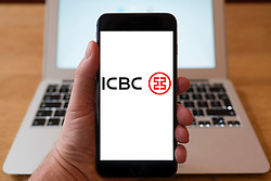 Using iPhone smartphone to display logo of ICBC (Industrial and Commercial Bank of China) Chinese bank