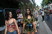 Notting Hill Carnival on 25th August 2019 in West London, United Kingdom. A celebration of West Indian / Caribbean culture and Europes largest street party, festival and parade. Revellers come in their hundreds of thousands to have fun, dance, drink and let go in the brilliant atmosphere. It is led by members of the West Indian / Caribbean community, particularly the Trinidadian and Tobagonian British population, many of whom have lived in the area since the 1950s. The carnival has attracted up to 2 million people in the past and centres around a parade of floats, dancers and sound systems.