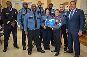 Members of the Power Shift / Elementary Rover team receive the Unit Citation of the Year award from Chief Robert Mock, right, during the Houston ISD Police awards banquet at Thompson Elementary School, August 15, 2014.