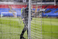 Steward disinfect the Post during the EFL Sky Bet League 2 match between Bolton Wanderers and Cheltenham Town at the University of  Bolton Stadium, Bolton, England on 16 January 2021.