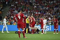 May 26, 2018 - Kiev, Ukraine - Referee talks to Liverpool's midfielder Jordan Henderson during the UEFA Champions League Final match at NSC Olipiyskyi stadium in Kyiv, Ukraine, May 26, 2018. (Credit Image: © Sergii Kharchenko/NurPhoto via ZUMA Press)
