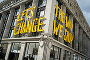 On the day that the UK government eased Covid restrictions to allow non-essential businesses such as shops, pubs, bars, gyms and hairdressers to re-open, the Selfridges department store displays their slogan about changing the way we shop, on 12th April 2021, in London, England.