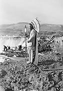 9305-B7365-3. William Yallup at Celilo Falls. September 1938.