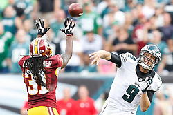Philadelphia Eagles quarterback Nick Foles #9 throws the ball over a defender during the NFL Game between The Washington Redskins and The Philadelphia Eagles at Lincoln Financial Field in Philadelphia on Sunday September 21st 2014. The Eagles won 37-34. (Brian Garfinkel/Philadelphia Eagles)