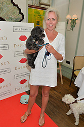 AMANDA BRETHERTON and her dog Max at a party hosted by Lulu Guinness and Daphne's to launch Lulu's Designer Dog Bowl and to mark Daphne's allowing dogs through it's doors, held at Daphne's, Draycott Avenue, London on 28th June 2016.