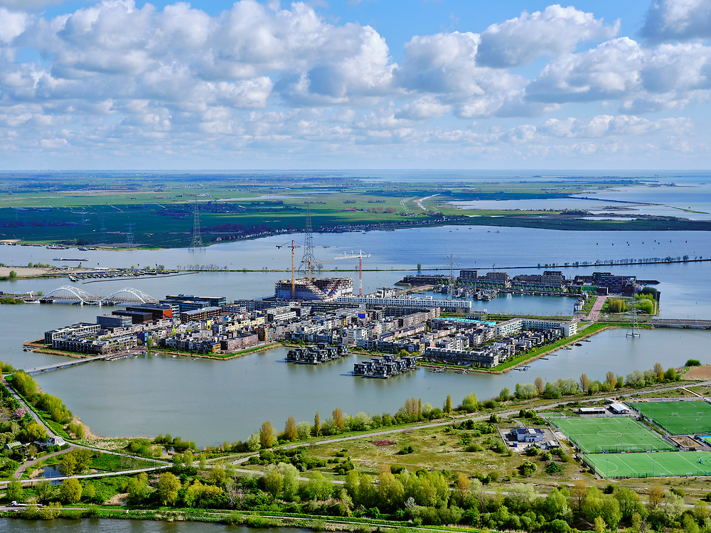 Nederland, Noord-Holland, Amsterdam, 07-05-2021; Steigereiland IJburg gezien vanuit Diemen-Noord. Vuilstortplaats Diemerzeedijk nu Diemerpark in de voorgrond. <br /> IJburg seen from Diemen-Noord. Garbage dump Diemerzeedijk now Diemerpark in the foreground.<br /> luchtfoto (toeslag op standaard tarieven);<br /> aerial photo (additional fee required)<br /> copyright © 2021 foto/photo Siebe Swart