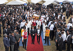 © Licensed to London News Pictures. 04/09/2016. London, UK. Friends and relatives carry a coffin at a joint funeral held at Winn's Common Park for five men who drowned at Camber Sands last month.  The five men: Kurushanth Srithavarajah, brothers  Kenigan and Kobi Nathan, Inthushan Sri and Nitharsan Ravi were all friends from London.  They got into difficulty in the sea of Camber Sands on August 24. Photo credit: Peter Macdiarmid/LNP