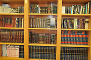 Jewish bookcase Jewish Prayer books (Sidur) and religious works on a shelf in a bookcase