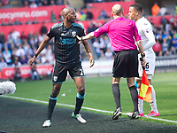 Football - 2016 / 2017 Premier League - Swansea City vs. West Bromwich Albion<br /> <br /> Nyom of W.B.A. & Martin Olson of Swansea separated by the linesman  , at Liberty Stadium.<br /> <br /> COLORSPORT/WINSTON BYNORTH