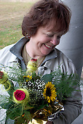 Visitor receiving bouquet of flowers upon arrival to Poland.  Zawady  Central Poland