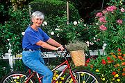 Senior woman on bicycle.