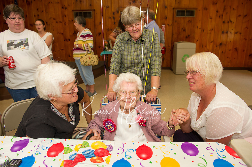 Bea Emond, Brenda Moulton, Doris Federspiel wish Gladys Burbank happy birthday wishes as she celebrated her 100th birthday during a party in her honor at Leavitt Park on Saturday afternoon.  (Karen Bobotas/for the Laconia Daily Sun)