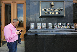 May 23, 2019 - Kiev, Ukraine - Relatives of deceased soldiers brought portraits of those who were killed in fighting against pro-Russian terrorists in the country's east, at the Presidential office in Kyiv, Ukraine, May 23, 2019. Relatives of deceased soldiers protested against allegedly possible negotiations with Russia. (Credit Image: © Sergii Kharchenko/NurPhoto via ZUMA Press)