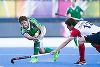 LONDON -  Unibet Eurohockey Championships 2015 in  London. 03 Ireland-France (4-3).  Kyle Good scores 1-0 . right French Corentin Saunier (Gk) . David Fitzgerald (l) with Alexis Fourcroy.   WSP Copyright  KOEN SUYK