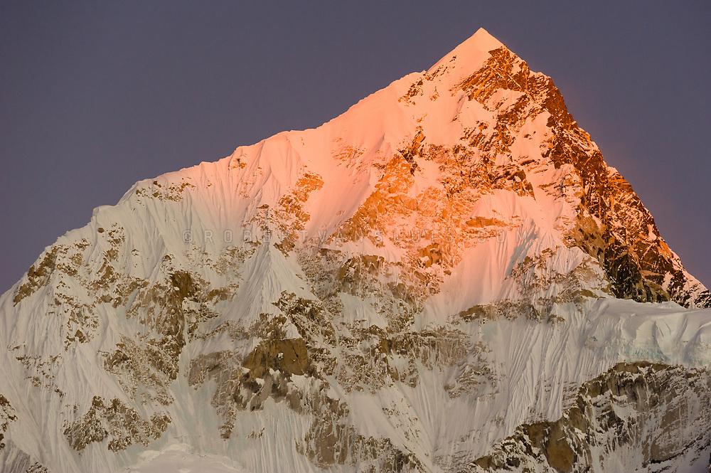 Sunset over Nuptse (7861 m) in the Nepal Himalaya. Photo © robertvansluis.com
