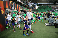 Zlatan Ibrahimovic Forward of Manchester United and mascot walking onto the pitch during the Europa League match between Saint-Etienne and Manchester United at Stade Geoffroy Guichard, Saint-Etienne, France on 22 February 2017. Photo by Phil Duncan.