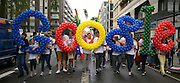 © Licensed to London News Pictures. 07/07/2012. London, UK Staff from google display the company logo made of balloons. Guests at the World Pride Procession in Central London today 7th July 2012. Despite reports of it's cancellation due to financial difficulty the scaled-down event went ahead after changes to its schedule. Photo credit : Stephen Simpson/LNP