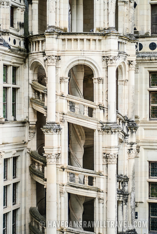 An outside view of the famous double-helix staircase at the Chateau de Chambord in the Loire Valley, a castle dating back to the 16th century. The two helices ascend the three floors without ever meeting, illuminated from above by a sort of light house at the highest point of the château. Some suggest Leonardo da Vinci may have designed the staircase.