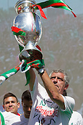 Portuguese coach Fernando Santos, shows the Euro Cup to the crowd of portuguese supporters at Alameda Dom Afonso Henriques, in Lisbon. Portugal's national squad won the Euro Cup the day before, beating in the final France, the organizing country of the European Football Championship, in a match that ended 1-0 after extra-time.