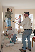 """Dale Squires, David Pereira, Mike Warmington and Rick Moses along with fellow Gilford Rotarians apply a fresh coat of paint to the Family Wing of the Carey House as part of the """"Adopt a Room"""" program.  (Karen Bobotas/for the Laconia Daily Sun)"""