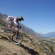 Lewis Hamilton from Rotorua in action during the New Zealand South Island Downhill Cup Mountain Bike series held on The Remarkables face with a stunning backdrop of the Wakatipu Basin. 150 riders took part in the two day event. Queenstown, Otago, New Zealand. 9th January 2012. Photo Tim Clayton