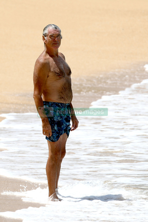 EXCLUSIVE: Pierce Brosnan takes a relaxing dip in Hawaii while escaping the Covid19 which has locked down Los Angeles. 02 Apr 2020 Pictured: Pierce Brosnan. Photo credit: MEGA TheMegaAgency.com +1 888 505 6342