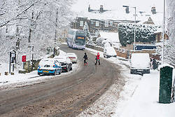 Monday January 21 Commuters make thier way through the  Winter Weather as it hits reaches Ecclesfield in Sheffield South Yorkshire with the promise of more to follow .21 January 2013.Image © Paul David Drabble