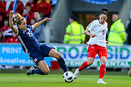 Geraldine Reuteler (#6) of Switzerland crosses for Lara Dickenmann (#11) of Switzerland to score Switzerland's first goal (2-1) during the 2019 FIFA Women's World Cup UEFA Qualifier match between Scotland Women and Switzerland at the Simple Digital Arena, St Mirren, Scotland on 30 August 2018.