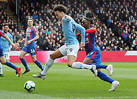 Football - 2018 / 2019 Premier League - Crystal Palace vs. Manchester City<br /> <br /> Leroy Sane of City and Aaron Wan - Bassaka of Palace, at Selhurst Park.<br /> <br /> COLORSPORT/ANDREW COWIE