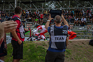 Coaches watch their riders during practice at the 2016 UCI BMX Supercross World Cup in Santiago del Estero, Argentina
