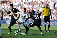 Swansea city's Leon Britton © is squeezed out by Fulham's Bryan Ruiz (l) and Eyong Enoh (33). Barclays Premier league, Swansea city v Fulham at the Liberty Stadium in Swansea, South Wales on Sunday 19th May 2013. pic by Andrew Orchard,  Andrew Orchard sports photography,