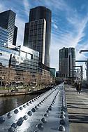 Melbourne, Australia - August 20, 2017: Pedestrians walk across the Sandridge Bridge, a historic former railway bridge over the Yarra River in Melbourne's Central Business District.