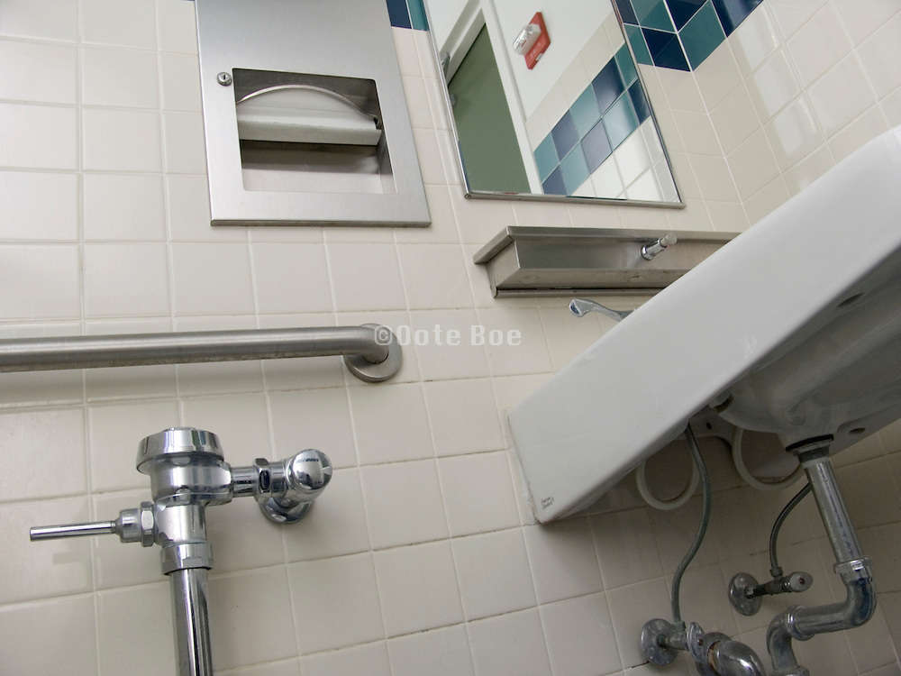 toilet room with grab bar