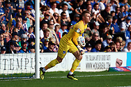 Portsmouth goalkeeper Craig MacGillivray (15) saves the ball during the EFL Sky Bet League 1 match between AFC Wimbledon and Portsmouth at the Cherry Red Records Stadium, Kingston, England on 13 October 2018.