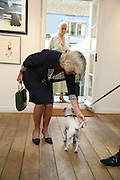 THE DUCHESS OF CORNWALL  WITH ARCHIE.  Norman Parkinson and Philip Treacy, an exhibition of photographs by Norman Parkinson and drawings by celebrated milliner Philip Treacy. ELEVEN Gallery. VICTORIA. LONDON. 3 July 2007.  -DO NOT ARCHIVE-© Copyright Photograph by Dafydd Jones. 248 Clapham Rd. London SW9 0PZ. Tel 0207 820 0771. www.dafjones.com.