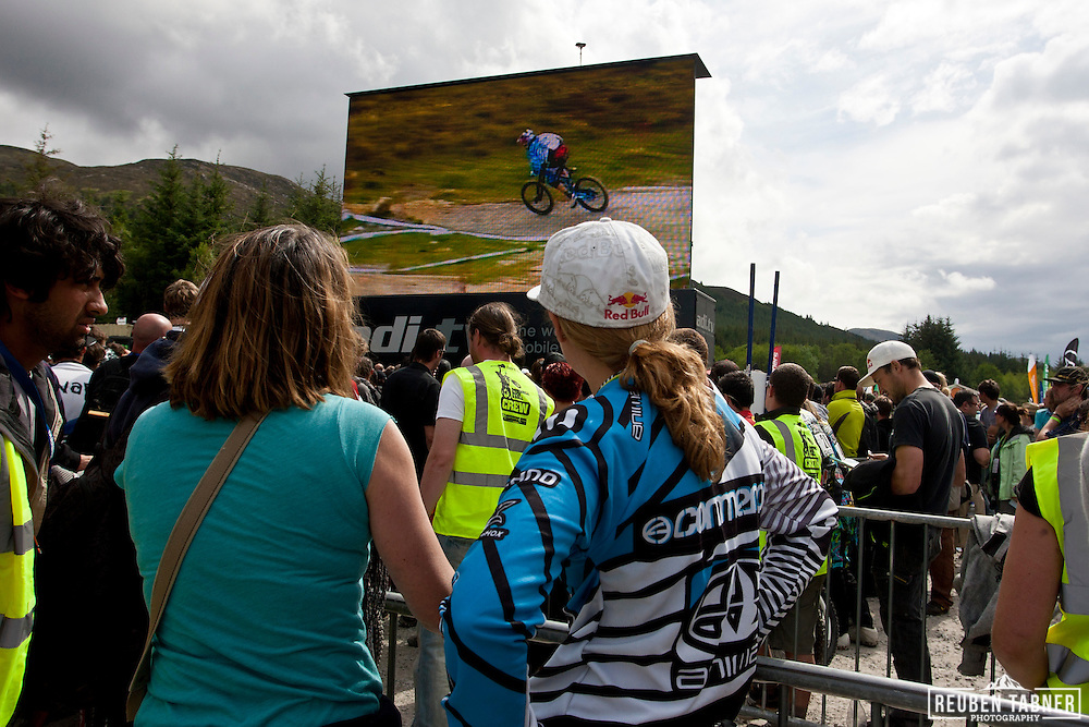 Rachel Atherton watches her brother Gee in his winning run, live on the big screen at the UCI Mountain Bike World Cup in Fort William, Scotland.