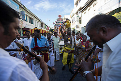 © Licensed to London News Pictures. 23/01/2016 Ipoh, Malaysia. Musicians and a devotees carrying pots of milk lead the chariot carrying the deity Lord Murugan on its way to the Kallumalai Murugan Temple in Ipoh, Malaysia, during the Thaipusam Festival, Saturday, Jan. 23, 2016. Photo credit : Sang Tan/LNP