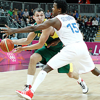 02 August 2012: Lithuania Jonas Maciulis passes the ball past Mickael Gelabale during 82-74 Team France victory over Team Lithuania, during the men's basketball preliminary, at the Basketball Arena, in London, Great Britain.