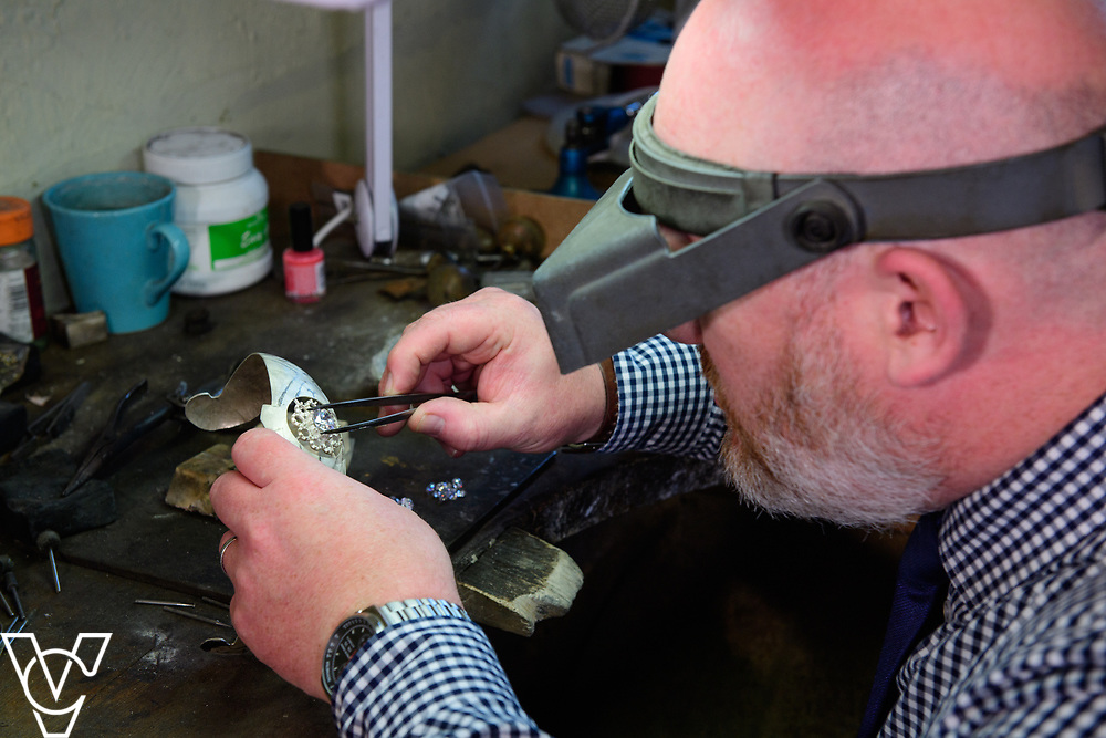 COUNTY NEWS: James Usher Jewlers, in Lincoln, are hand-making a replica of the tiara worn by Meghan Markle during her recent wedding to Prince Harry.  Pictured is James Usher manager Scott Ward inspecting the tiara which is currently being made.<br /> <br /> Picture: Chris Vaughan Photography<br /> Date: June 28, 2018