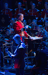 © London News Pictures. Pictured: Lieutenant Kevin Roberts, Senior Director of Music conducts The Bands of The Household Division at The Royal Albert Hall, London during the Festival of Remembrance on Saturday 7th November 2015... Photo credit: Max Bryan/LNP