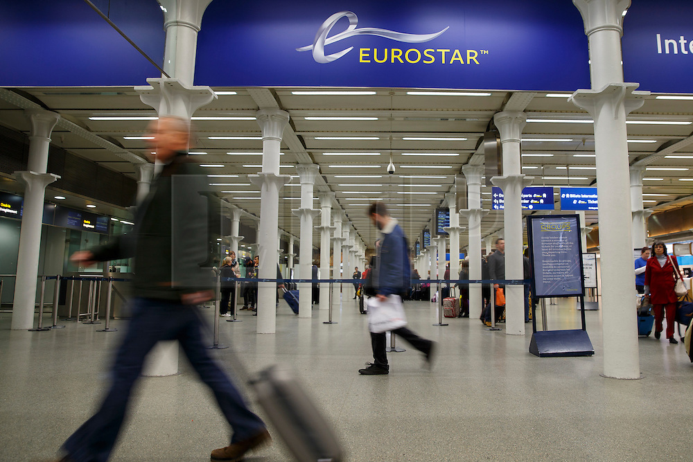© Licensed to London News Pictures. 13/10/2014. LONDON, UK. Passengers checking in to travel on Eurostar at St. Pancras International station in London on Monday, 13 October 2014. The UK government is seeking buyers for its 40% stake in the cross-Channel train operator Eurostar to help boost the public finances. Photo credit : Tolga Akmen/LNP