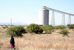RUSTENBURG SOUTH AFRICA - MAY 18: A protester returning home near the Seraleng mining community on May 18, 2020, in Rustenburg, South Africa. Seraleng residents gathered at Sibanye k5 mine shaft Communities in the area alleged complaints of food parcel corruption by a local ward councillor. Grievances also included concerns with unemployment, loss of business and access to a social labour plan. (Photo by Gallo Images/Dino Lloyd)