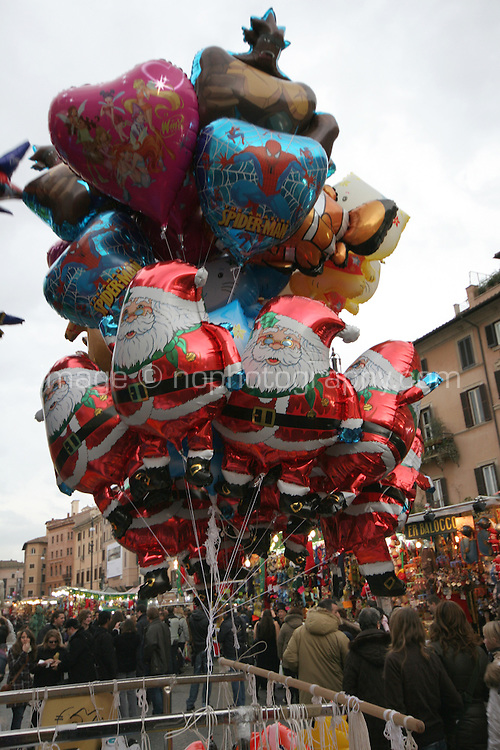 Santa balloons for sale at an outdoor market in Rome Italy