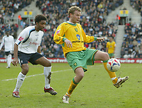 Photo: Aidan Ellis.<br /> Preston North End v Norwich City. Coca Cola Championship. 08/04/2006.<br /> Norwich's Jonatan Johansson is watched closely by Preston's Youl Mawene