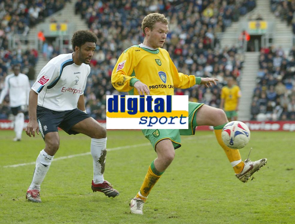 Photo: Aidan Ellis.<br /> Preston North End v Norwich City. Coca Cola Championship. 08/04/2006.<br /> Norwich's Jonatan Johansson is watched closely by Preston's Youl Mawene