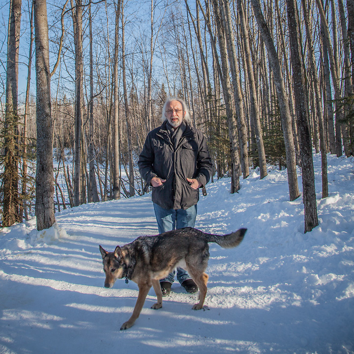 """Mark Kostreba and his dog Kivi at University Lake Dog Park, Anchorage  """"I have a lot of pictures of my prior two dogs, but not that many of myself with my third dog, Kivi.  She's a sweet dog.""""  mark-kostreba@gci.net"""