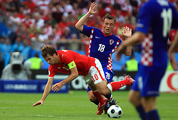 Captain of Austria Andreas Ivanschitz felt because of Croatian Ivica Olic during the UEFA EURO 2008 Group B soccer match between Austria and Croatia at Ernst-Happel Stadium, on June 8,2008, in Vienna, Austria.  (Photo by Vid Ponikvar / Sportal Images)