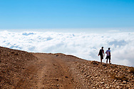Two men, one Lebanese and the other British, hike in the barren mountains high above the Lebanese town of Bcharre.
