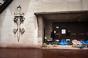 Calais, France, 20 februari 2015, Situation of the migrants of Calais. Syrian refugees find shelter at one of the churches of Calais. Every catholic celebration, the priest asks the refugees to clean the entrance.